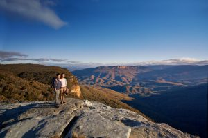Mandatory credit Hugh Stewart Destination NSW_Couple enjoying the sun rise over the Blue Mountains National Park