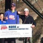 Shotover Canyon Swing Dalice McGregor and Roberts Krastins handing over a fundraising cheque to Ferg from BGYT