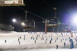 Skiers hitting Bourke Street at Mt Buller the during Light The Night eve...