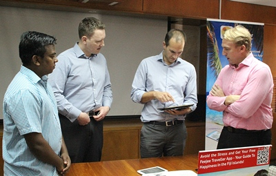 Tourism Fiji CEO, Matthew Stoeckel (2nd right) says the Feejee Traveller App is a fantastic tool for international visitors. PHOTO Kelvin Anthony