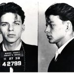 "BERGEN COUNTY, NJ - 1938:  Pop singer Frank Sinatra poses for a mug shot after being arrested and charged with ""carrying on with a married woman"" in 1938 in Bergen County, New Jersey. (Photo by Michael Ochs Archives/Getty Images)"