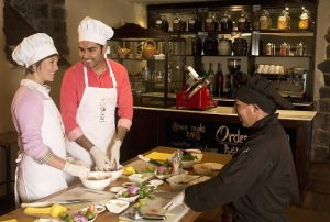 Hands-on cooking classes, making Peruvian fusion dishes. (PRNewsFoto/Southwind Adventures)