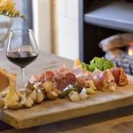 A traditional Raclette with assorted charcuterie takes diners to the hea...