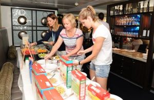 bronte-campbell-and-po-guests-enjoy-a-healthy-uncle-tobys-breakfast-onboard-pacific-dawn