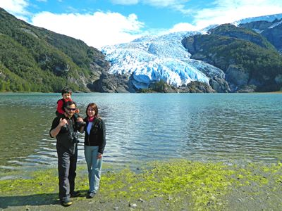 Family on Australis cruise in front of glacier