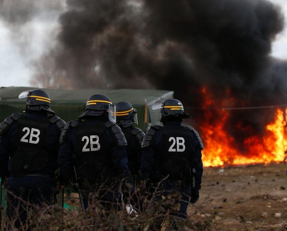 French police confront fire in section of Jungle camp