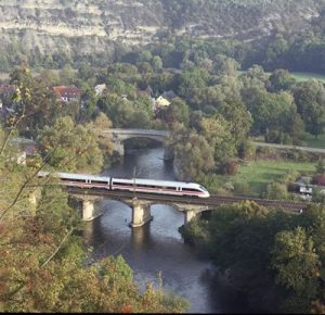 German train over the Rhine River