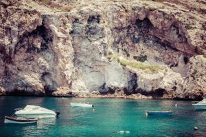 Xlendi, Malta - July 21, 2015: Boats at Xlendi Bay.