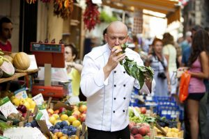 SeaDream Chef Tomasz Kozlowski buys fresh produce at the Sorrento market for that night's Raw Food dinner offerings.