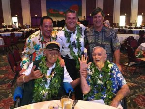 Sitting (l-r): Buffalo Keaulana; George Downing Standing (l-r): George Kam, Quiksilver Ambassador of Aloha; George D. Szigeti, Hawaii Tourism Authority President and CEO; Keone Downing, son of George Downing