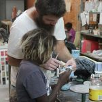 ceramics-technician-joey-burns-with-a-young-student-at-ernabella-arts