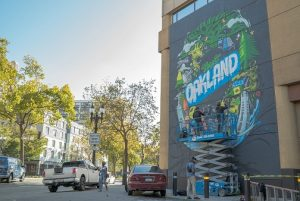 marriottmural-3_the-illuminaries-work-on-the-visit-oakland-mural-in-downtown-oakland