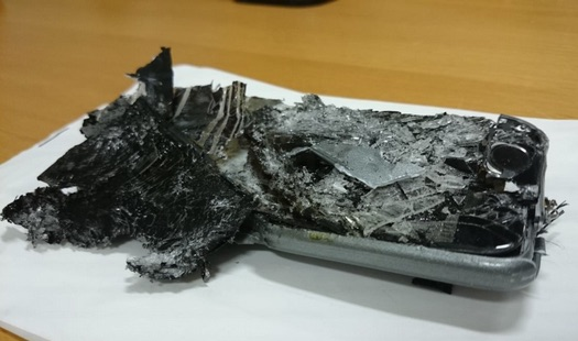 the-crushed-and-burned-phone-after-removal-from-seat-atsb
