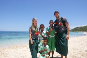 Matilda Rice and Art Green being welcomed by children of Kesa Village