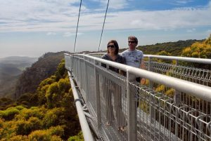 Couple walking along the Illawarra Fly Treetop Walk in Robertson, Southern Highlands