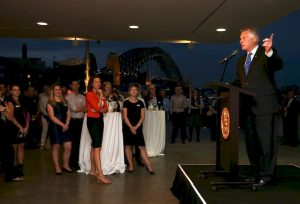 governor-mcauliffe-addresses-guests-with-sydney-harbour-bridge-in-background