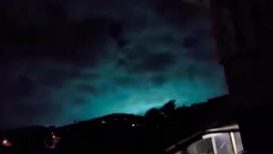 Unearthly lights flicker across sky