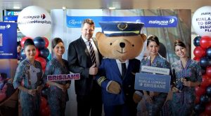 Malaysia Airlines Cabin Crew With Chief Commercial Officer Arved Von Our Muehlen And Mascot Pilot Parker